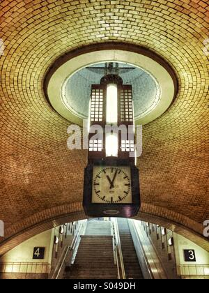 An Art Deco style clock in a Berlin tube station. - Stock Photo