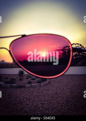 Sunset through sun glasses - Stock Photo