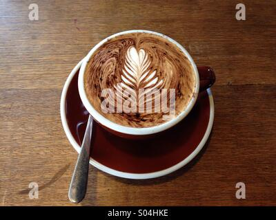 Cup of coffee cappuccino  in a cafe - Stock Photo