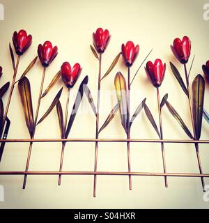 A metal wall hanging in a tulip design - Stock Photo