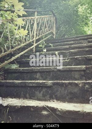 Old steps and iron railings - Stock Photo