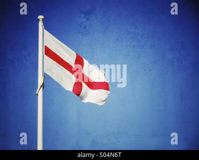 St George's cross English flag against a blue sky - Stock Photo