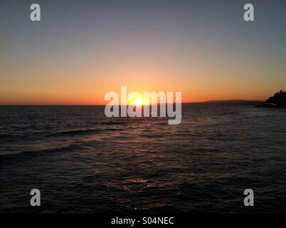 Beautiful sunset over the San Clemente Pier. - Stock Photo