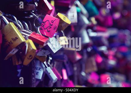 Love locks on the wall at the Romeo and Juliet balcony in Verona, Italy. - Stock Photo