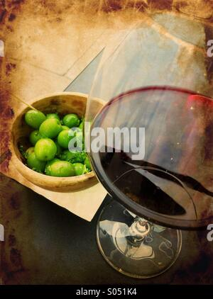 Nostalgia with glass of red wine and fresh green olives in a wine bar, Portobello Road, London - Stock Photo