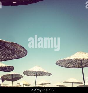 Alacati sun umbrellas - Stock Photo