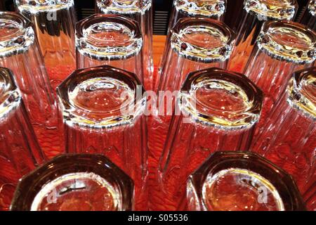 Bar glasses bottoms up - Stock Photo