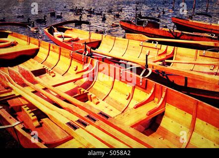 Moored rowing boats on Derwent Water in Lake District - Stock Photo