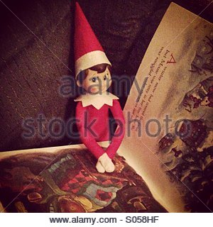 Elf on shelf - Stock Photo