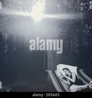 reading in hammock - Stock Photo