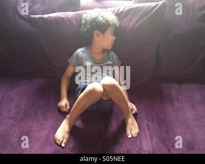 Boy fallen asleep - Stock Photo