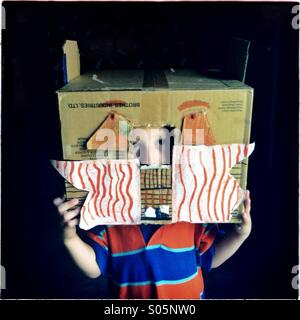 Boy in a cardboard box - Stock Photo