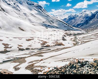 Manali Leh Highway at Baralacha Pass in Himachal Pradesh covered with snow in the Spring season. - Stock Photo