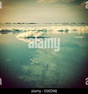 Foam on the beach, detail - Stock Photo