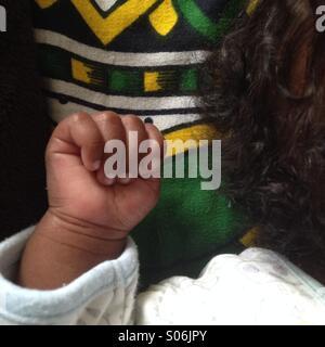 Sleeping baby fist - Stock Photo