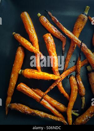 Fresh carrots simply roasted with salt and olive oil - Stock Photo
