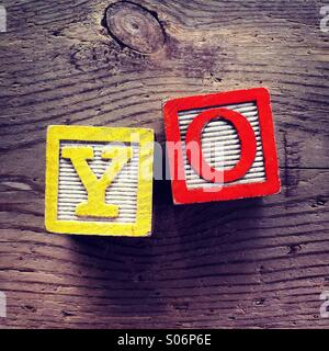 It's a photo of woodblocks toys will alphabet letter on them which are combines together to create the word YO - Stock Photo