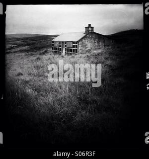 Old shieling on Isle of Lewis in Outer Hebrides - Stock Photo