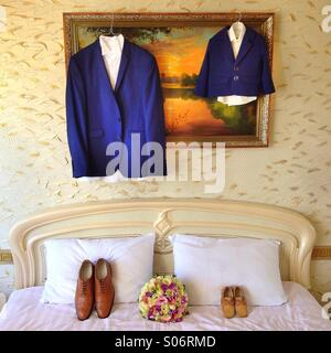 Wedding accesories, groom suit and his son suit - Stock Photo
