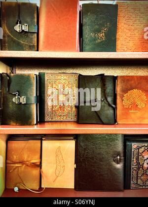 Personal journals with leather covers. - Stock Photo