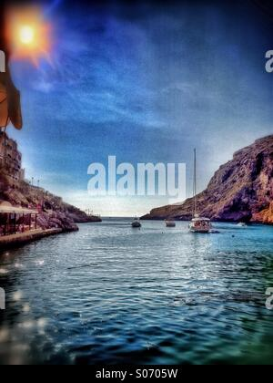 Nearing sunset in small fishing village on Island in the Mediterranean - Stock Photo