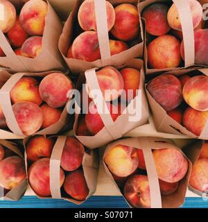 Farmers Market Peaches - Stock Photo