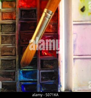 Well used artists watercolour palette and brush - Stock Photo
