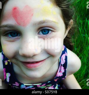 5 year old girl with face painting - Stock Photo