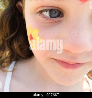 Close up of five year old girls face with face painting - Stock Photo