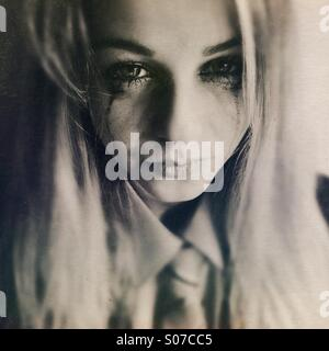 Teenage girl in school uniform, crying - Stock Photo