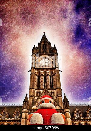Santa on Manchester Town Hall in Albert Square - Stock Photo