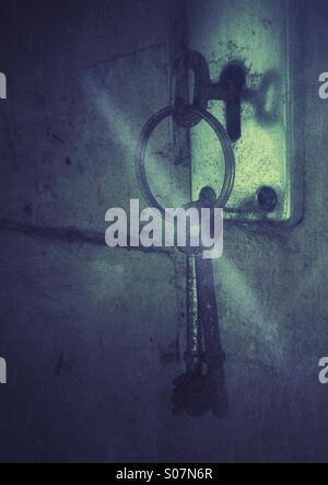 Rusty keys in old door lock. - Stock Photo