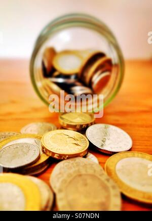 An emptied savings jar - Stock Photo