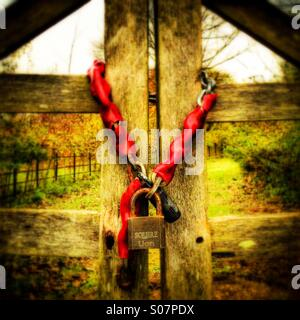Locked wooden gate - Stock Photo