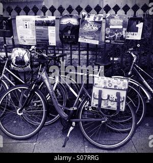 Bicycles leaning up against a fence, Cambridge UK - Stock Photo
