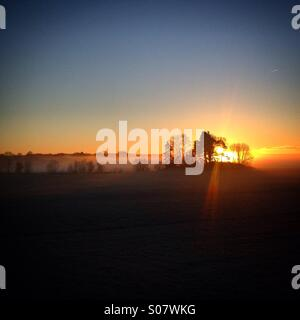 Sunrise over morning sea mist in the Åland archipelago in the Baltic Sea between Finland and Sweden - Stock Photo