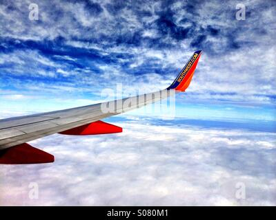 View out an airplane window on Southwest Airlines - Stock Photo