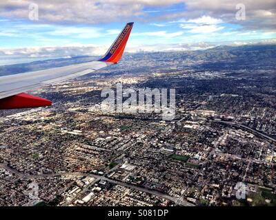 View out airplane window over San Jose, California. - Stock Photo