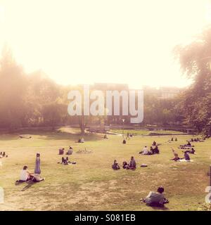 People enjoying late afternoon sun in Weinsbergweg Park, Mitte, Berlin, Germany - Stock Photo