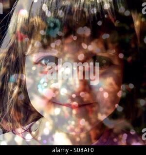 Multiple exposure toddler girl and Christmas lights. - Stock Photo