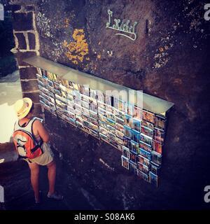 Tourist choosing a postcards - Stock Photo