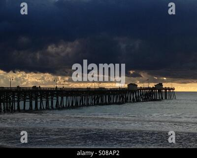 San Clemente pier at sunset after a passing storm, California USA. - Stock Photo
