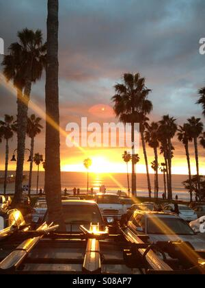 Fiery sunset with palm trees in San Clemente California USA. - Stock Photo
