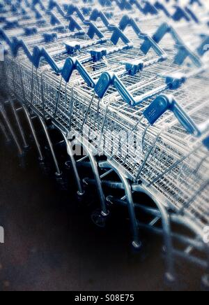 Shopping trolleys - stacked supermarket trolleys - Stock Photo
