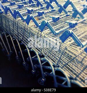 Shopping trolleys - supermarket trolleys - Stock Photo