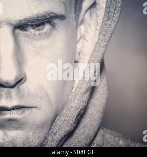 Angry male looking at camera with copy space - Stock Photo