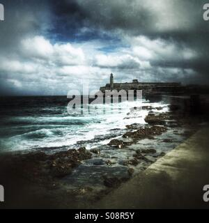 View of the El Morro lighthouse from the Malecon seawall on a stormy day. Havana Cuba Caribbean - Stock Photo