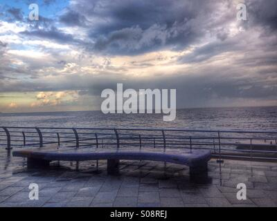 Empty bench in a raining day early morning on the promenade - Beirut Lebanon - Stock Photo