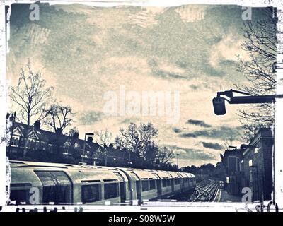 Tube train at Ealing Common underground station, London, UK