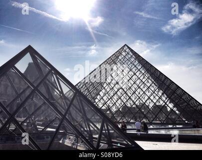 Louvre Glass Pyramids in Paris - Stock Photo